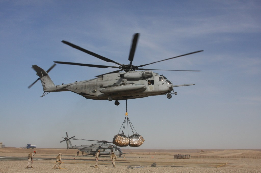 A CH-53E picks up an external load at Camp Bastion Afghanistan during deployment in 2011